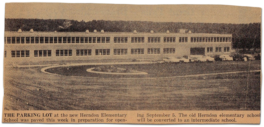 Photograph of a newspaper article featuring a picture of Herndon Elementary School on Dranesville Road. The caption reads: The parking lot at the new Herndon Elementary School was paved this week in preparation for opening September 5. The old Herndon elementary school will be converted to an intermediate school.