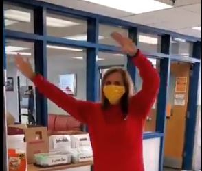 Mrs. Fennessy is dancing wearing a bee mask.