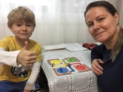 Mom and son playing board game