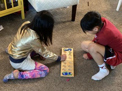 Ms. Choi's kids playing board games